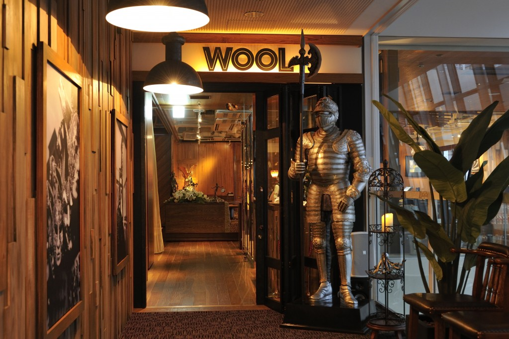 A stylish modern entrance with medieval armor on display.
