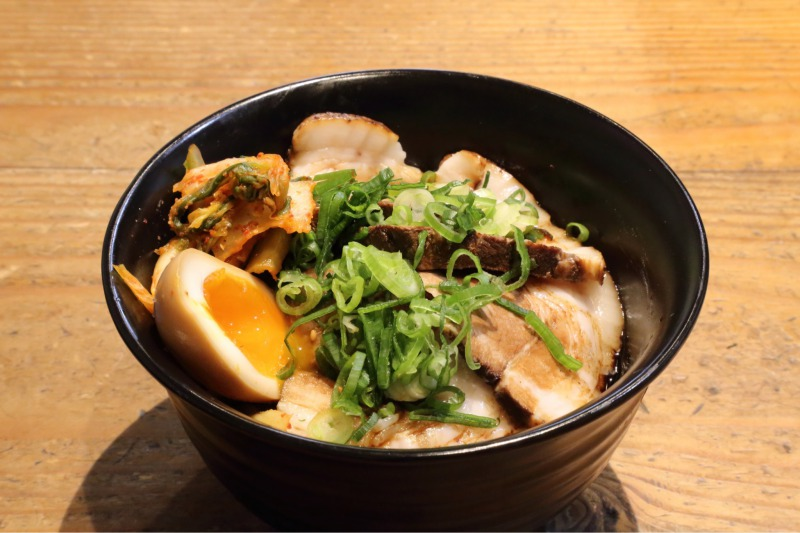 Kura don (rice bowl) with their signature Chashu, simmered egg and kimchi on top.